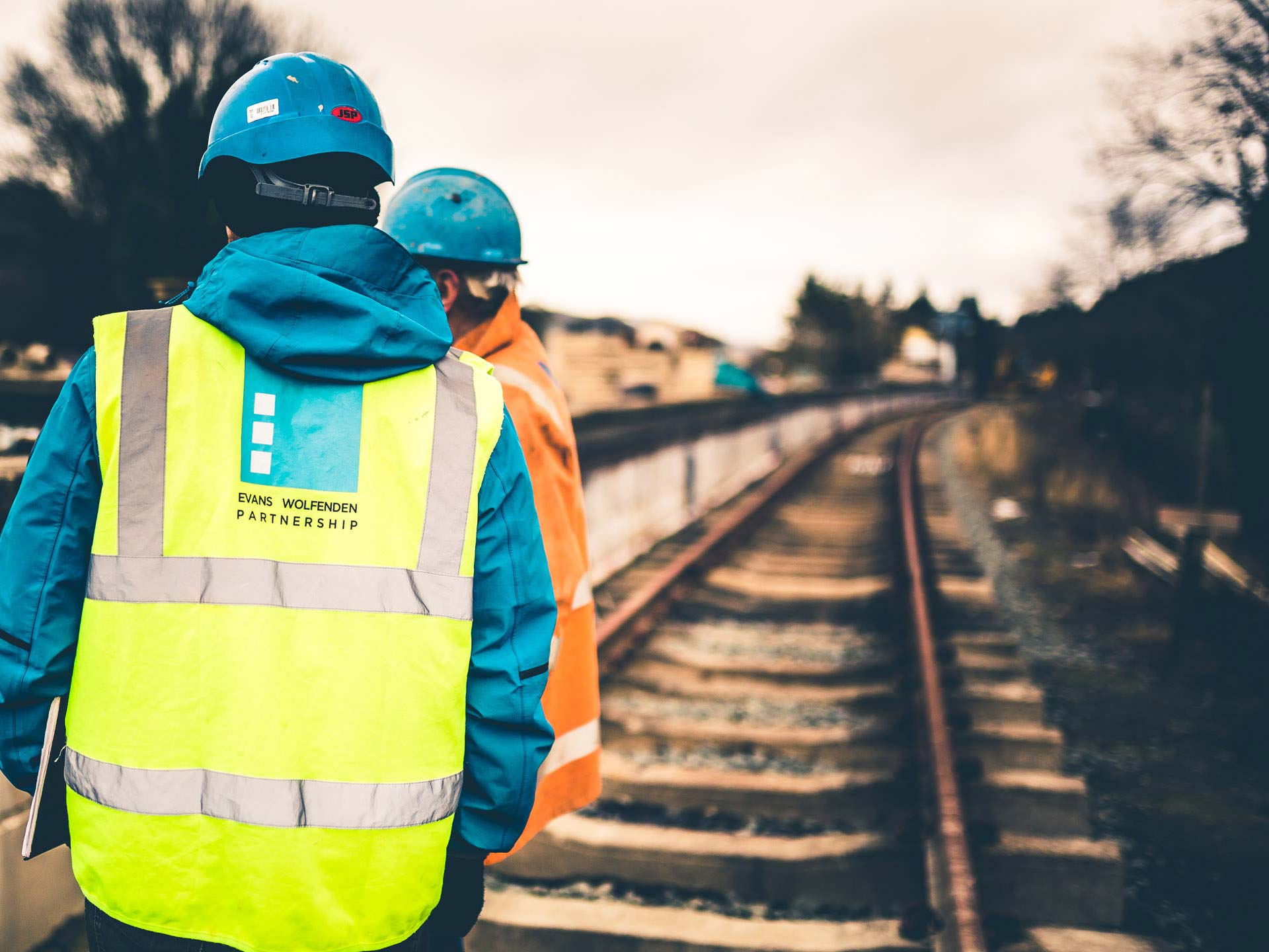 Engineers wearing construction gear at Llangollen Railway project